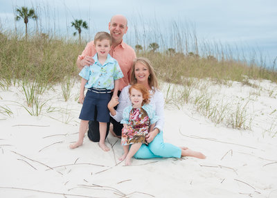 small family sitting on Grayton beach