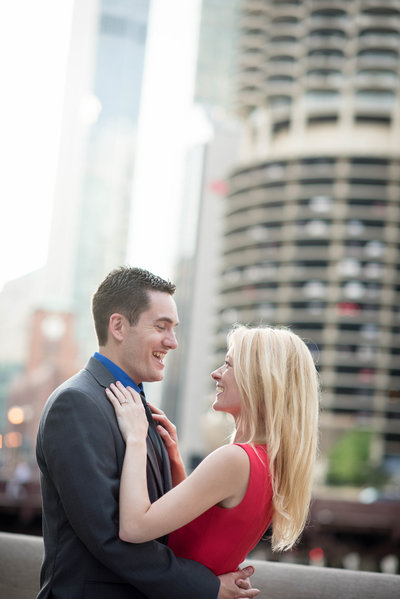 Chicago engagement, Riverwalk, dusk, red dress, laughing.