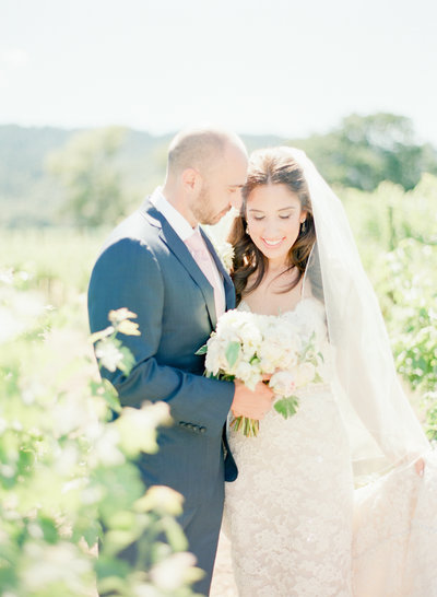 Newly wed bridal portrait in Napa vineyard, photo by Evonne and Darren Fine Art Wedding Photographers, Brix Restaurant & Gardems vineyard wedding venue  California