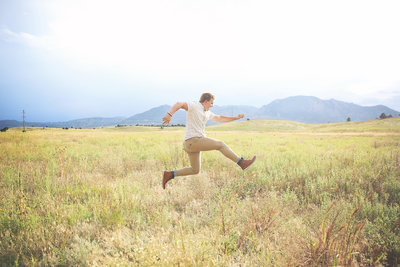 senior boy jumping for joy in Boulder, CO by Leighellen Landskov Photography.  Simple, Joyful, Authentic.