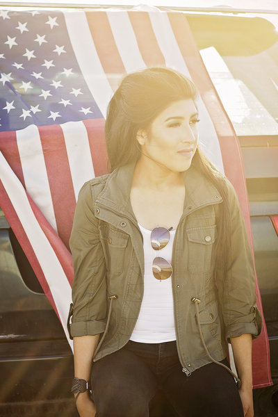 outdoor sun flare half body portrait of girl in front of American Flag