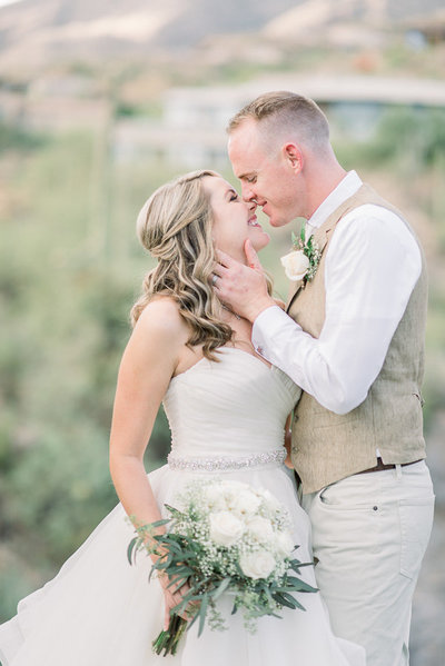 Lodge at Ventana Canyon Wedding photo of Bride and Groom Kissing by Tucson Wedding Photographer Bryan and Anh of West End Photography