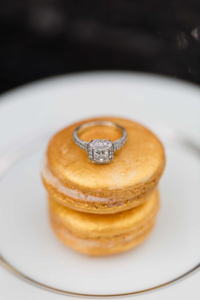 Gold Macaron's stacked with a diamond engagement ring perched on top