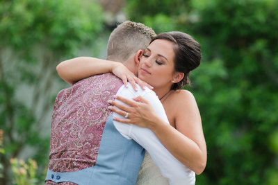 Bride and groom are captured in the moment as they hug it out on their wedding day taking it all in,  in the garden  at Southend Barns wedding venue in Chichester