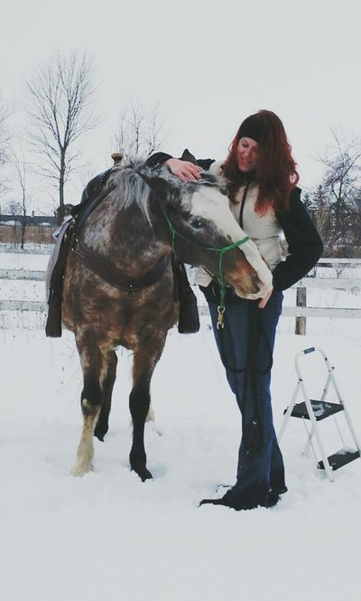 Casi playing with her Spanish Mustang, Scout, in the middle of Winter