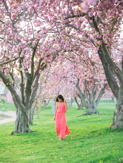Girl surrounded by Cherry Blossom Trees