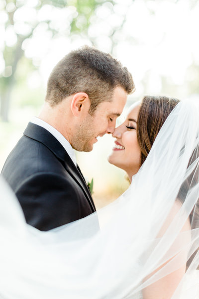 Bride and groom kissing at Napa wedding