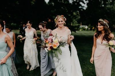 Bride and Bridesmaids with Wedding Bouquets at Red Maple Vineyard wedding flowers. Hudson Valley wedding florist.