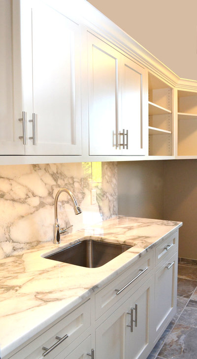 creamy laundry room with white marble top