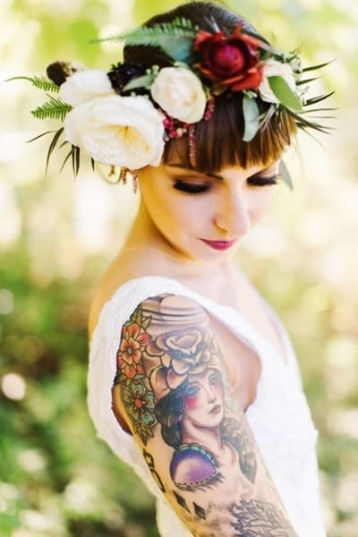 Bohemian tattooed bride wearing a flower crown at Ashokan Dreams wedding venue in the Catskills