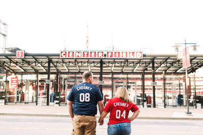 Engagement photos in front of St. Louis Busch Stadium for Hannah & Eric by Jackelynn Noel Photography