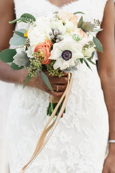 ribbon hanging from a bridal bouquet