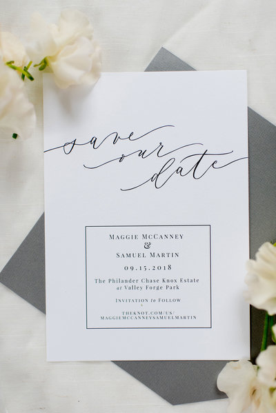 Beautiful modern white and black calligraphy save the date