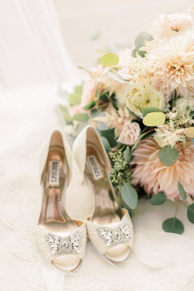 bridal details shot with shoes and flowers