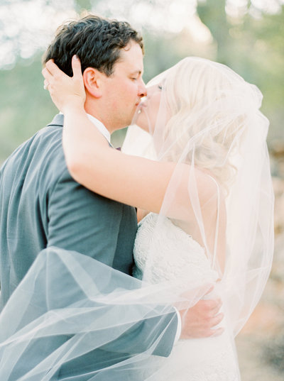 Bride and groom kissing in Phoenix wedding