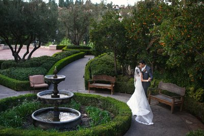 Bride and Groom kissing with fountain at Rancho Bernardo Inn