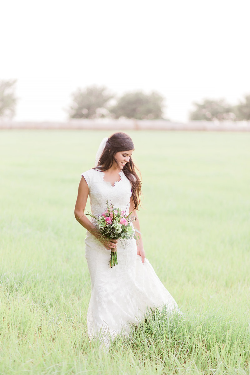 Bride walking through a Texas field