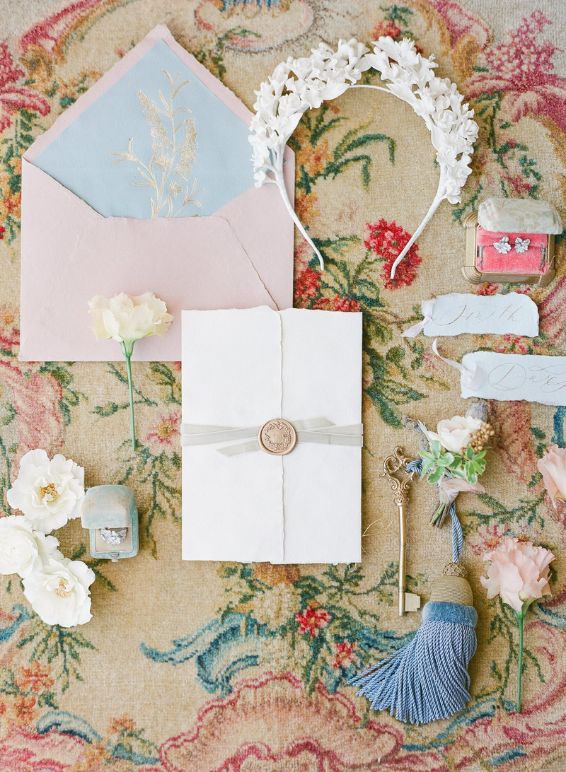 Flat lay of wedding invitation in Paris, France
