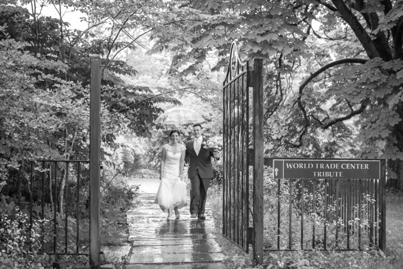 Bride and groom in rainy day wedding