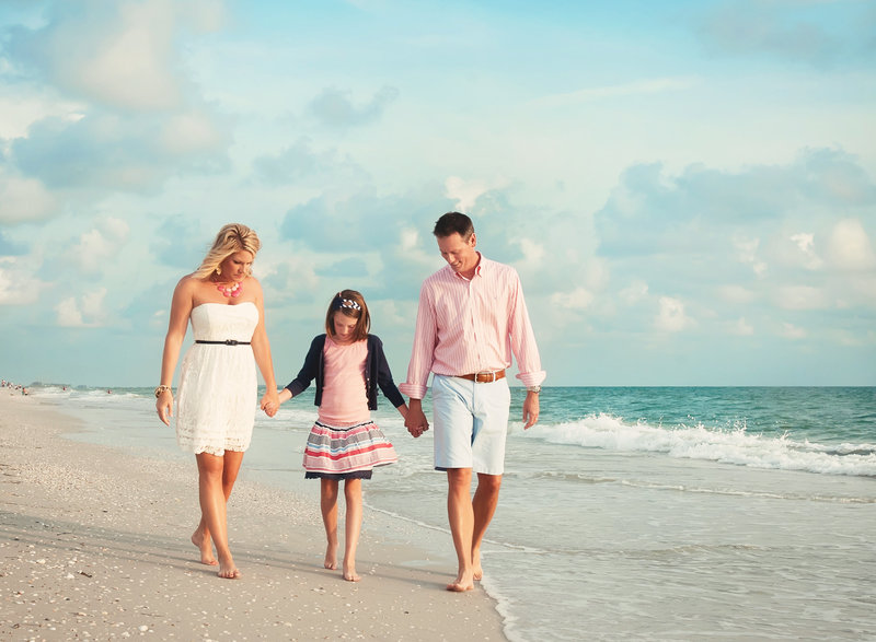 young family walking along the shoreline in Rosemary Beach