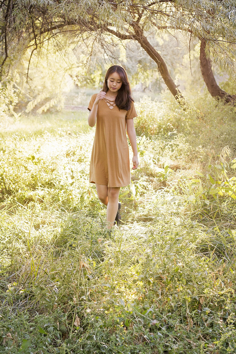 Outdoor full body portrait of high school senior in field