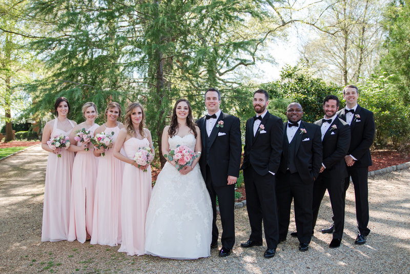 Rsowell bridal party in pink dresses and black tuxedos