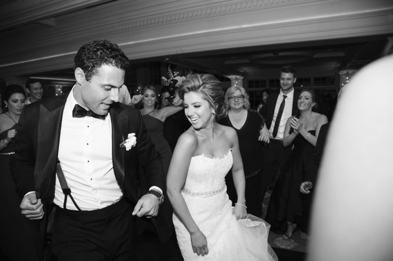 black and white bride and groom dance at wedding reception