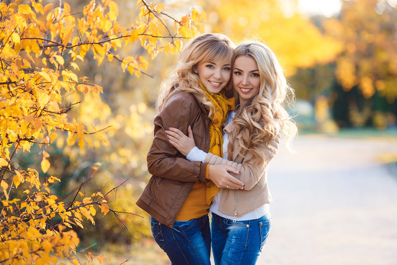 bigstock-Two-beautiful-blonde-in-autumn-110296574