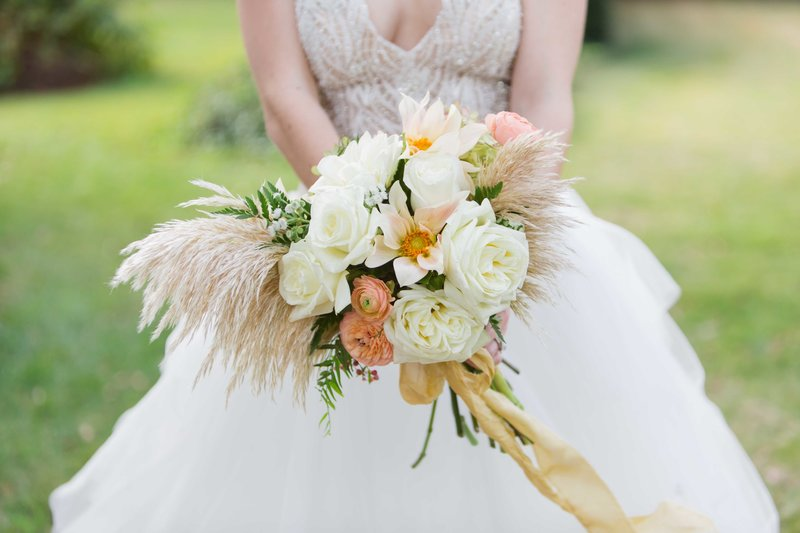 Bride holds a great gatsby inspired fern bouquet