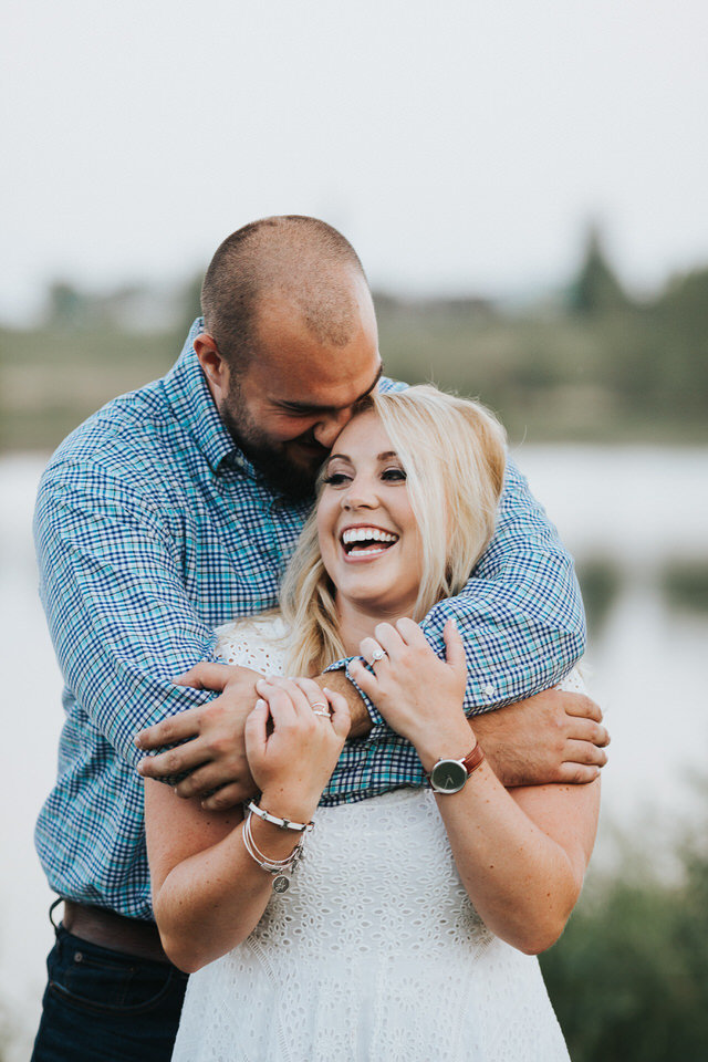 Engagement photos at Prairie Lakes Park in Cedar Falls, the pretzel pose