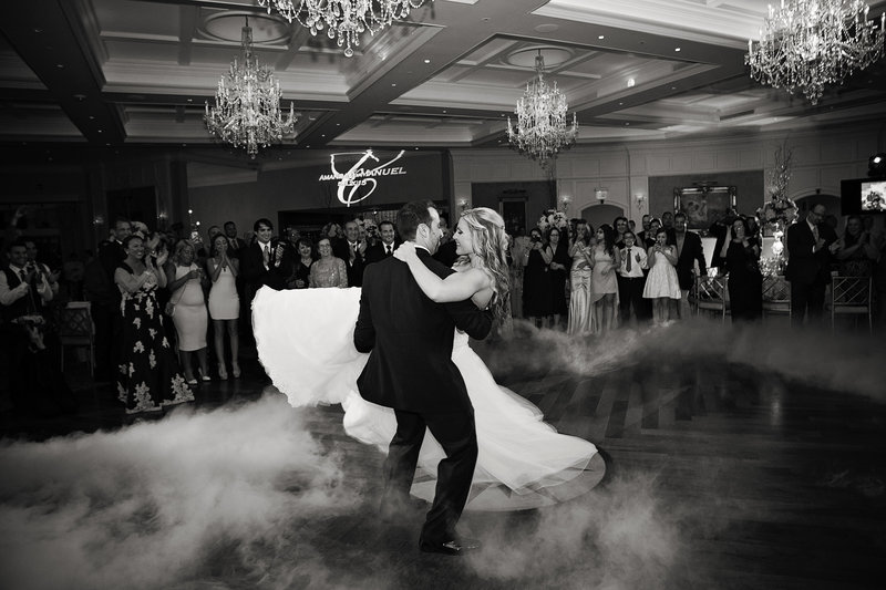 first dance black and white groom holds bride