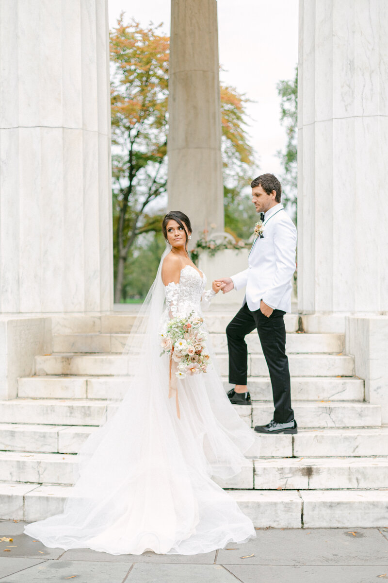 bride and groom standing on stairs at Washington DC Romantic Classic Wedding at the Lincoln Memorial by Costola Photography