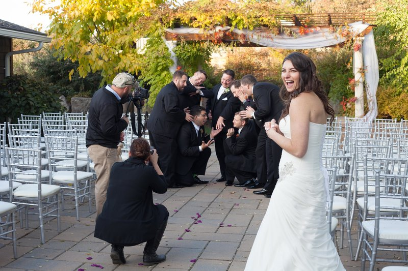 Wedding photographer poses