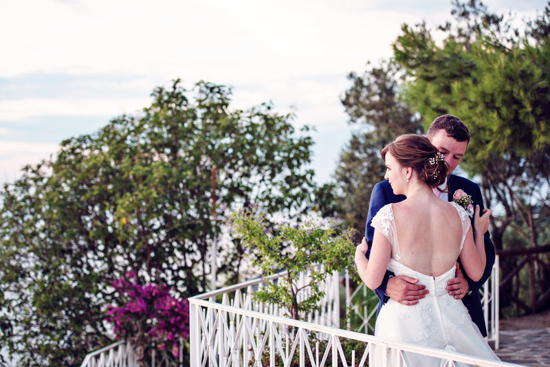 Bride and Groom looking out at Capri during their evening wedding reception