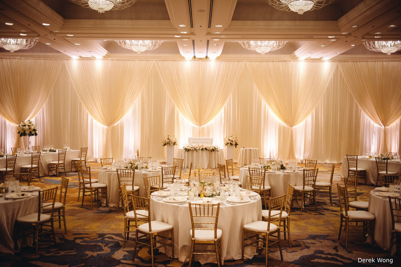 WM Four Seasons Ocean pipe & drape ivory linen gold chiavari chairs