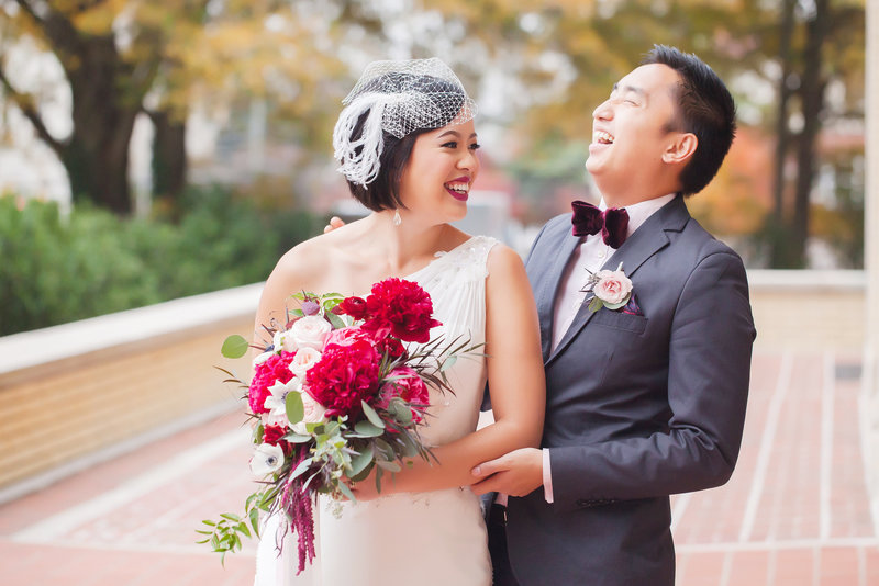 Bride and groom laughing, a natural unposed fine art wedding portrait by Casey Hendrickson