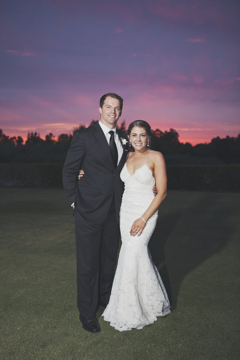 Beautiful sunset picture with a bride and groom in Orange County