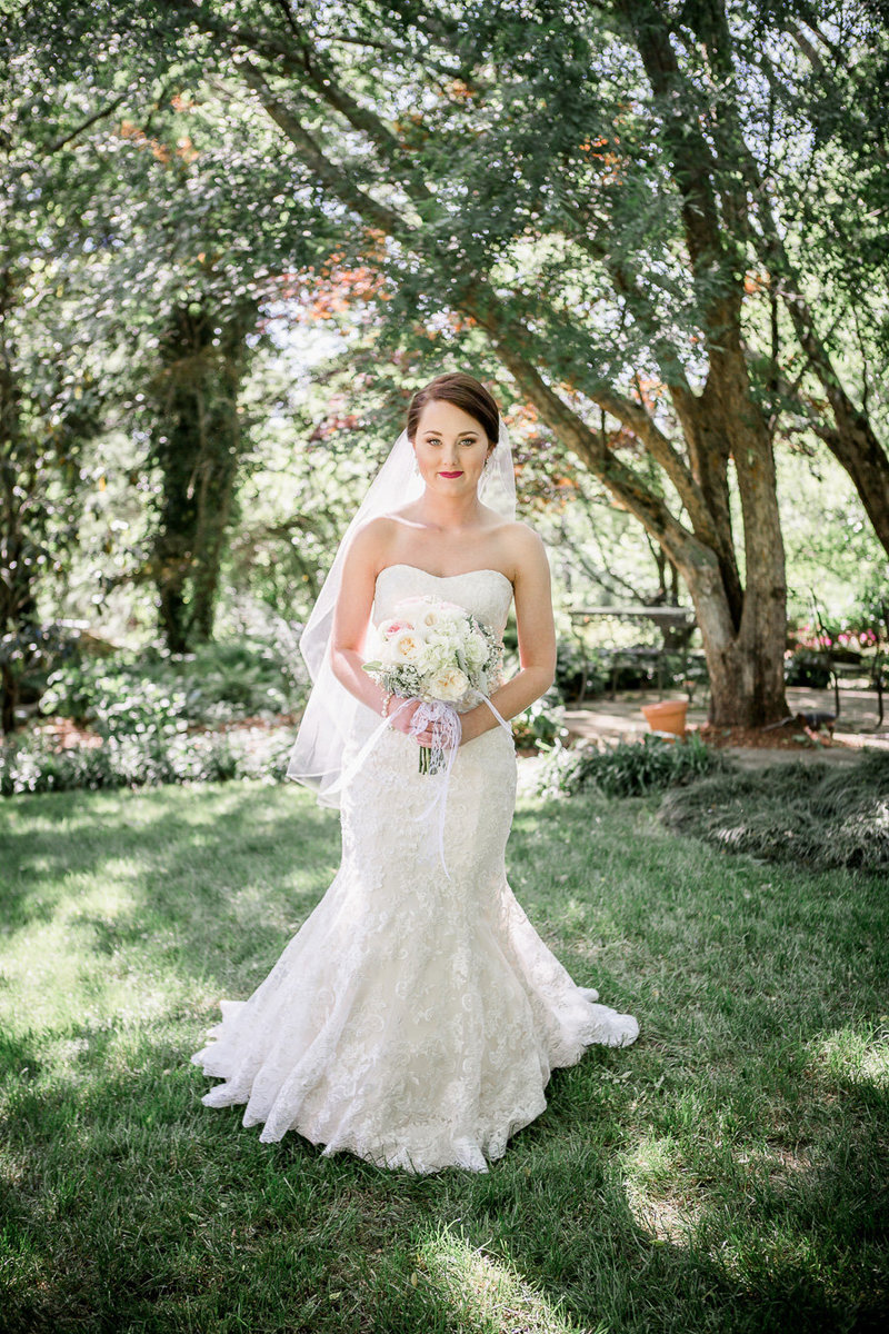 Bride walking towards camera at Black Fox Farms Wedding Venue by Knoxville Wedding Photographer, Amanda May Photos.