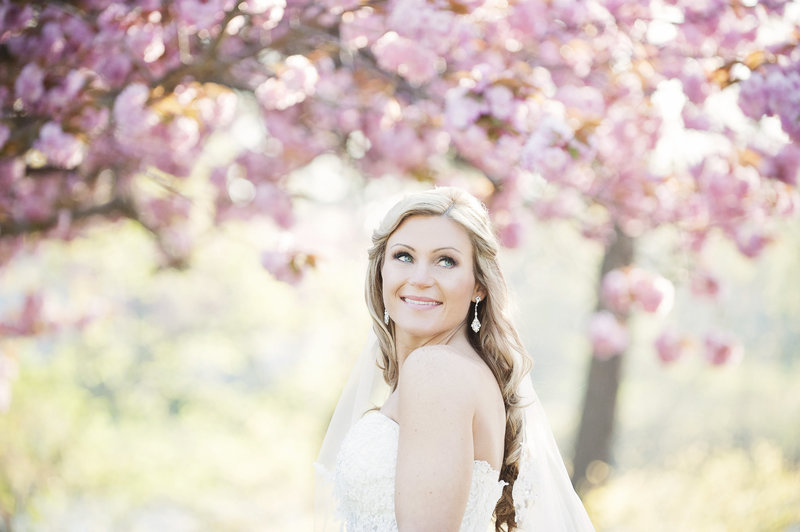 brides smiling and shining with cherry blossoms