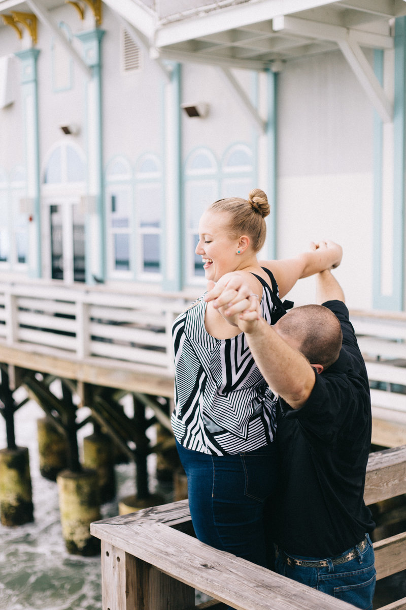 Daytona Beach Pier Engagement Photo of Deana and Alex by Sidney Baker-Green