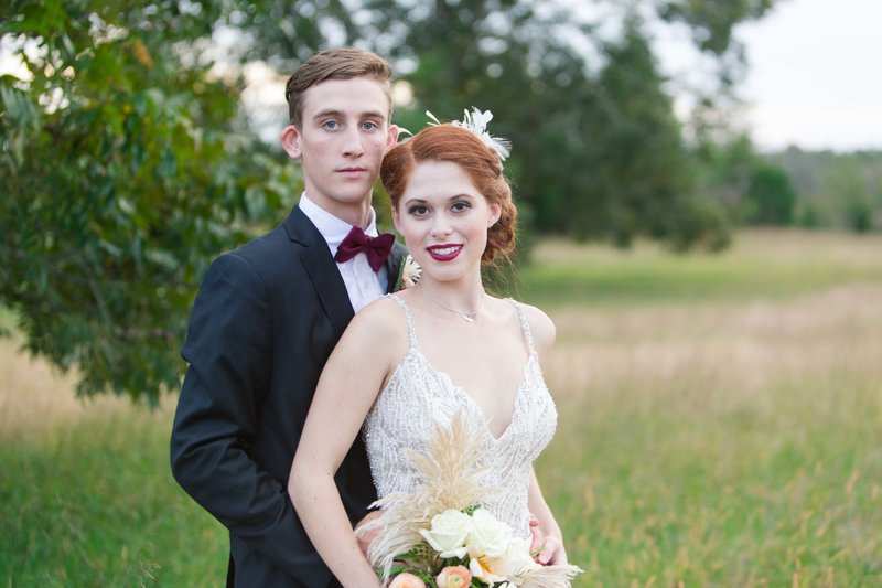 Great gatsby inspired wedding couple in a field at parterre