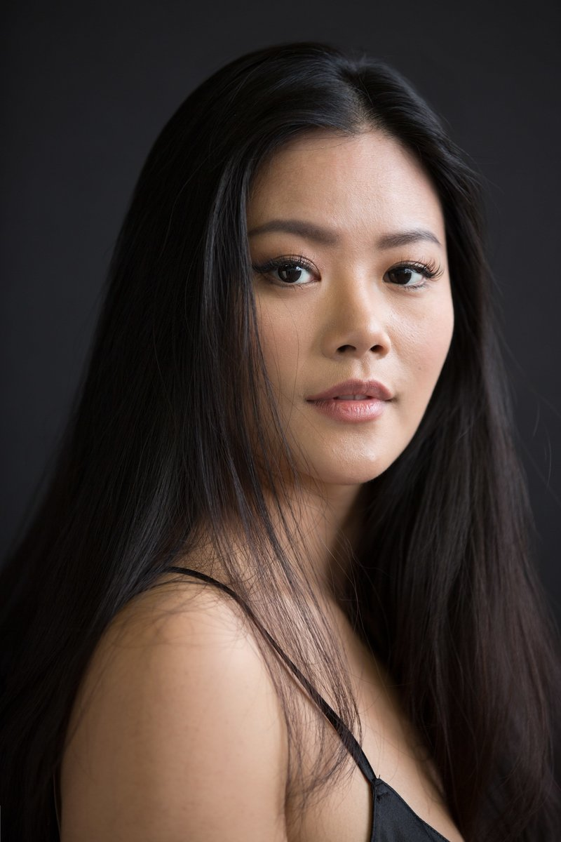Portrait of a young Asian woman on a black background