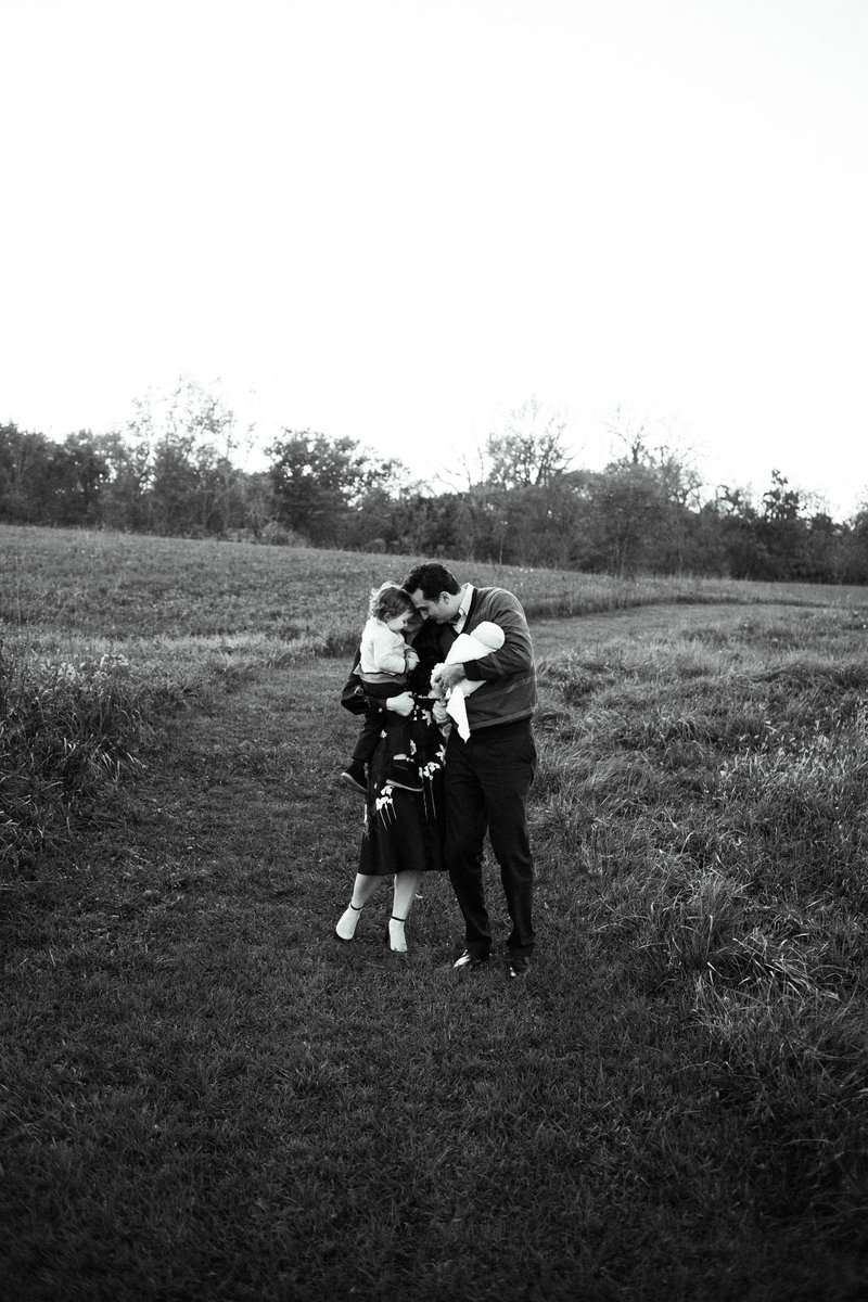 Family of four walking at sunset session, photos by Elle Baker Photography, Naperville forest preserve