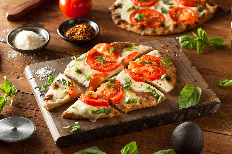 Fresh mozzarella tomato basil oven roasted pizza from deposit photos