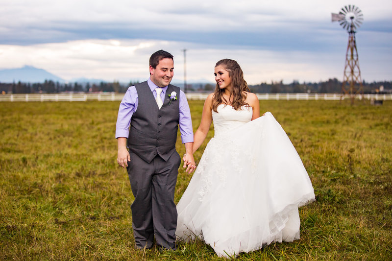 bride and groom on cow farm seattle wedding photographer emma lee photography