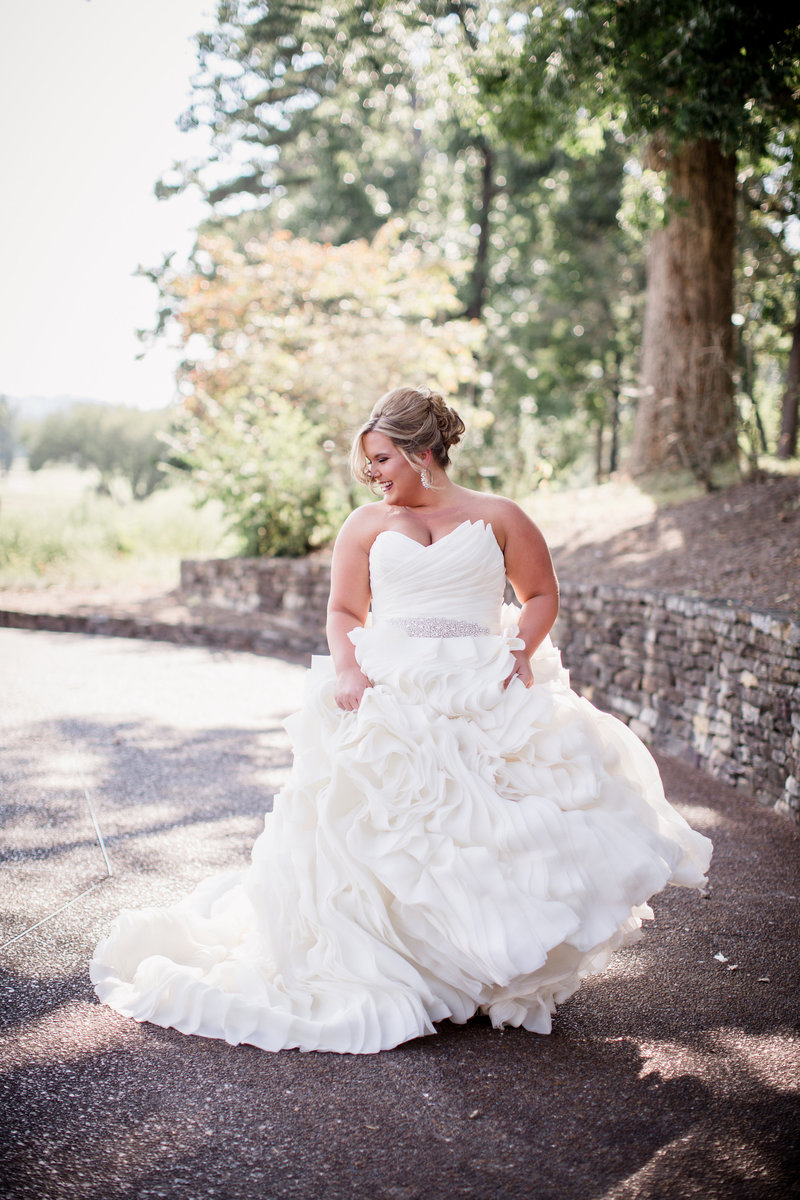 Bride twirling in her dress at Holston Hills Country Club Wedding venue by Knoxville Wedding Photographer, Amanda May Photos.