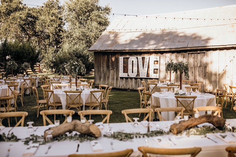 outdoor wedding reception  outside next to barn