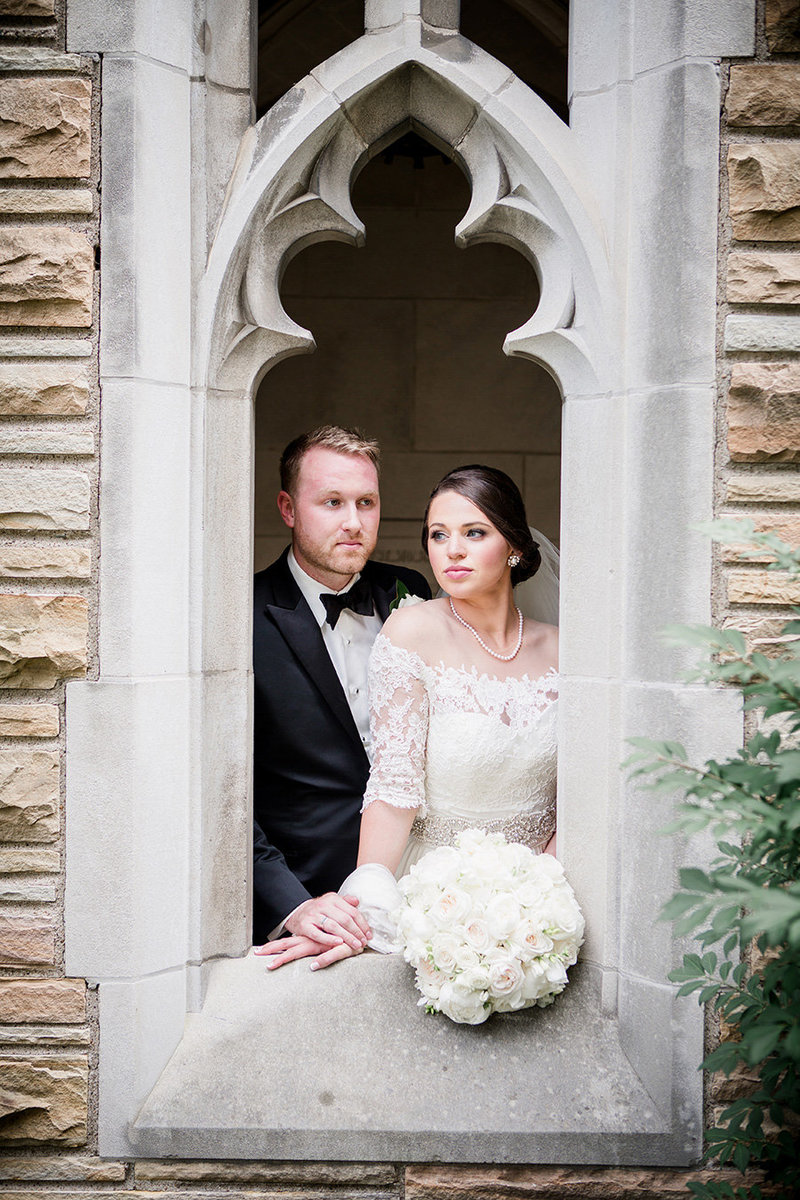 Bride and groom peering through chapel window at Scarrett Bennett by Knoxville Wedding Photographer, Amanda May Photos.