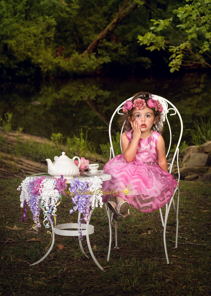 young girl dressed up as princess at tea party