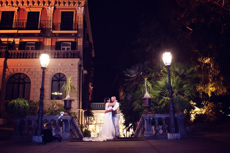 Bride and Groom in the evening at their wedding reception  in front of the Grand Excelsior Vittoria Sorrento